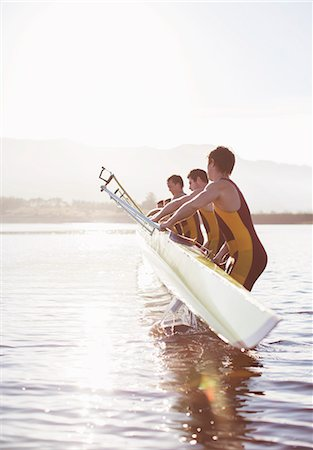 side view of person rowing in boat - Rowing team placing boat in lake Stock Photo - Premium Royalty-Free, Code: 6113-07588651