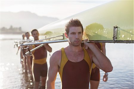 sport rowing teamwork - Rowing team carrying scull out of lake Stock Photo - Premium Royalty-Free, Code: 6113-07588670