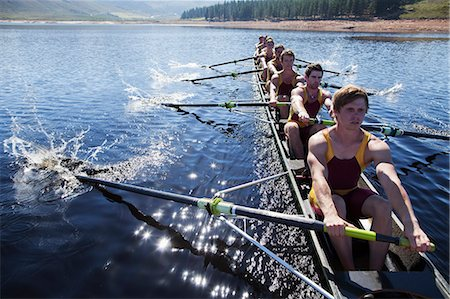 sport rowing teamwork - Rowing team rowing scull on lake Stock Photo - Premium Royalty-Free, Code: 6113-07588674