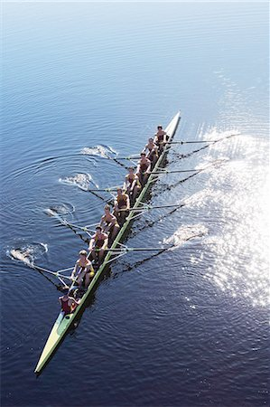 sport rowing teamwork - Rowing team rowing scull on lake Stock Photo - Premium Royalty-Free, Code: 6113-07588678