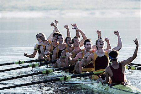 sport rowing teamwork - Rowing team celebrating in scull on lake Stock Photo - Premium Royalty-Free, Code: 6113-07588684