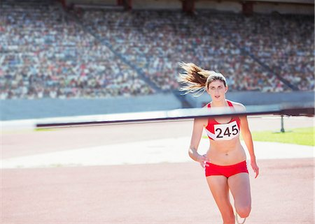 race track (people) - High jumper nearing pole Stock Photo - Premium Royalty-Free, Code: 6113-07588693