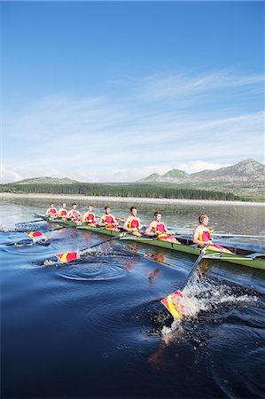 sport rowing teamwork - Rowing crew rowing scull on lake Stock Photo - Premium Royalty-Free, Code: 6113-07588698