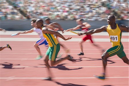 sprint - Blurred view of relay runners in race Stock Photo - Premium Royalty-Free, Code: 6113-07588639