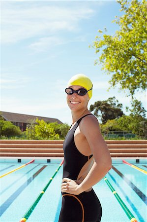 sports - Portrait of smiling swimmer at poolside Stock Photo - Premium Royalty-Free, Code: 6113-07588756