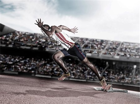 race track (people) - Runner taking off from starting block on track Stock Photo - Premium Royalty-Free, Code: 6113-07588760