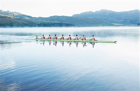 sport rowing teamwork - Rowing team rowing scull on lake Stock Photo - Premium Royalty-Free, Code: 6113-07588761