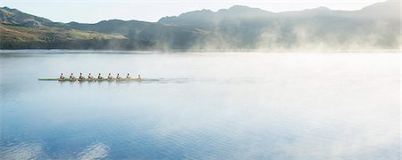 sport rowing teamwork - Rowing team rowing scull on lake Stock Photo - Premium Royalty-Free, Code: 6113-07588772