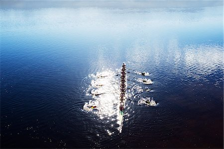 sport rowing teamwork - Rowing team rowing scull on lake Stock Photo - Premium Royalty-Free, Code: 6113-07588777