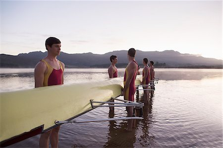 side view of person rowing in boat - Rowing team holding scull in lake at dawn Stock Photo - Premium Royalty-Free, Code: 6113-07588774
