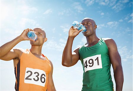 runner (male) - Runners drinking water on track Stock Photo - Premium Royalty-Free, Code: 6113-07588776