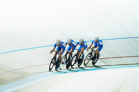 Track cyclists riding in velodrome Stock Photo - Premium Royalty-Free, Code: 6113-07588779
