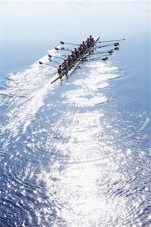 sport rowing teamwork - Rowing team rowing scull on sunny lake Stock Photo - Premium Royalty-Free, Code: 6113-07588781