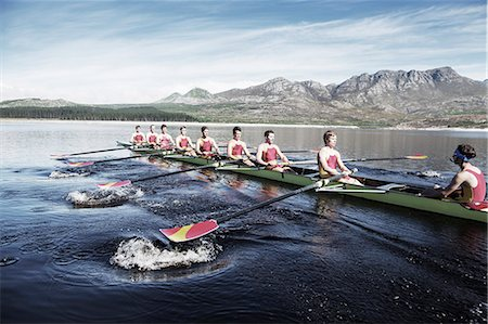 sport rowing teamwork - Rowing team rowing scull on lake Stock Photo - Premium Royalty-Free, Code: 6113-07588787