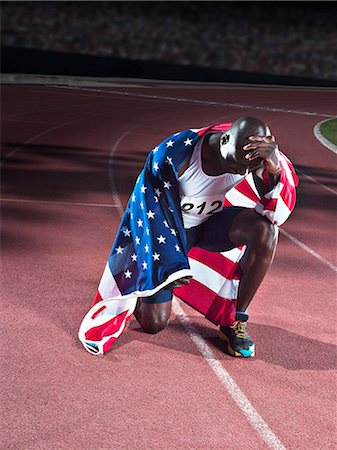 race track (people) - Track and field athlete wrapped in American flag on track Stock Photo - Premium Royalty-Free, Code: 6113-07588797
