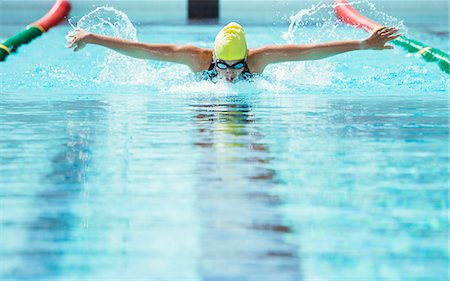 swimming - Swimmer racing in pool Stock Photo - Premium Royalty-Free, Code: 6113-07588702