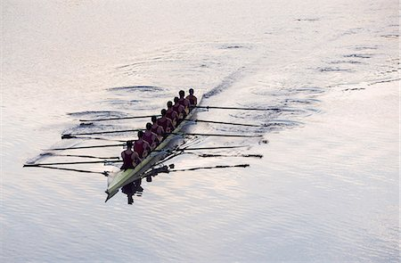 sport rowing teamwork - Rowing team rowing scull on lake Stock Photo - Premium Royalty-Free, Code: 6113-07588713