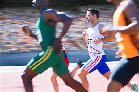 race track (people) - Runners racing on track Stock Photo - Premium Royalty-Free, Code: 6113-07588724