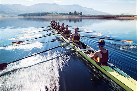 sport rowing teamwork - Rowing team rowing scull on lake Stock Photo - Premium Royalty-Free, Code: 6113-07588726