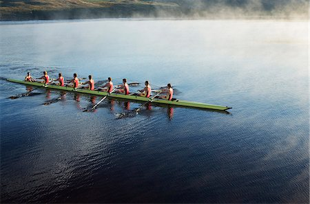 sport rowing teamwork - Rowing crew rowing scull on lake Stock Photo - Premium Royalty-Free, Code: 6113-07588738