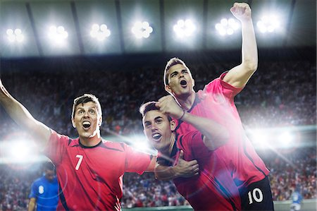 football team - Soccer players celebrating on field Stock Photo - Premium Royalty-Free, Code: 6113-07588840