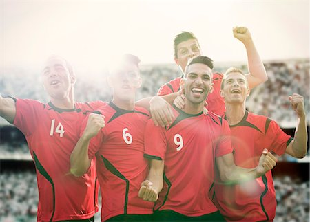 football team - Soccer team celebrating on field Stock Photo - Premium Royalty-Free, Code: 6113-07588845