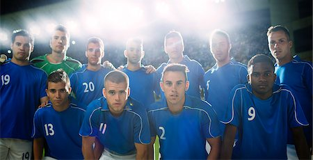football team - Soccer team standing in stadium Stock Photo - Premium Royalty-Free, Code: 6113-07588850
