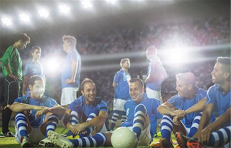 football team - Soccer team relaxing on field Stock Photo - Premium Royalty-Free, Code: 6113-07588857