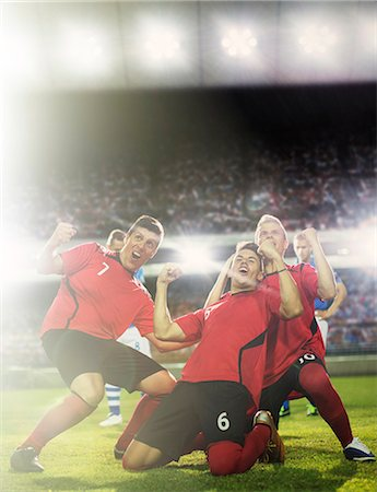 soccer player (male) - Soccer team celebrating on field Stock Photo - Premium Royalty-Free, Code: 6113-07588856