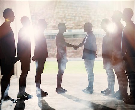 football team - Silhouette of soccer teams shaking hands Stock Photo - Premium Royalty-Free, Code: 6113-07588858