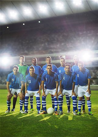 football team - Soccer team posing on field Stock Photo - Premium Royalty-Free, Code: 6113-07588859
