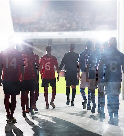 football team - Silhouette of soccer players walking to field Stock Photo - Premium Royalty-Free, Code: 6113-07588862