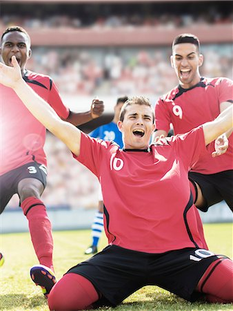 soccer player (male) - Soccer team celebrating on field Stock Photo - Premium Royalty-Free, Code: 6113-07588866