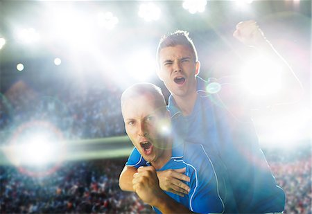 Soccer players celebrating on field Stock Photo - Premium Royalty-Free, Code: 6113-07588871