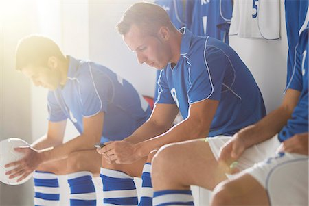 Soccer players sitting in locker room Stock Photo - Premium Royalty-Free, Code: 6113-07588878