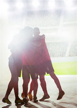 football team - Silhouette of soccer team celebrating Stock Photo - Premium Royalty-Free, Code: 6113-07588882