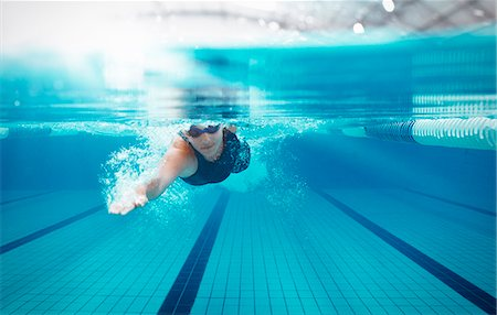 swimming - Swimmer racing in pool Stock Photo - Premium Royalty-Free, Code: 6113-07588803