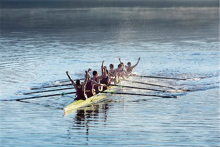 sport rowing teamwork - Rowing team celebrating in scull on lake Stock Photo - Premium Royalty-Free, Code: 6113-07588802