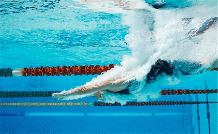 Swimmer diving into pool Stock Photo - Premium Royalty-Free, Code: 6113-07588806