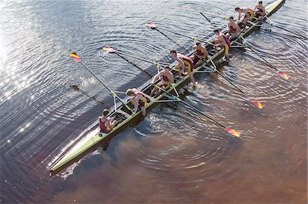 sport rowing teamwork - Rowing team in scull on lake Stock Photo - Premium Royalty-Free, Code: 6113-07588809