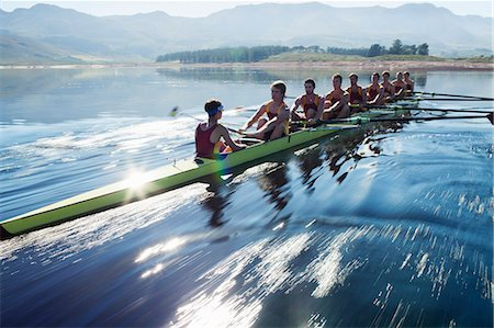 sport rowing teamwork - Rowing team rowing scull on lake Stock Photo - Premium Royalty-Free, Code: 6113-07588814