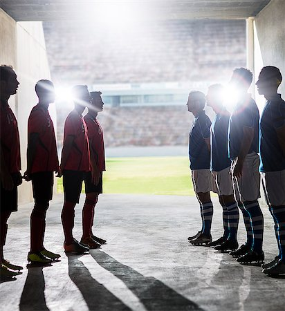 football team - Silhouette of soccer teams greeting in locker room Stock Photo - Premium Royalty-Free, Code: 6113-07588832