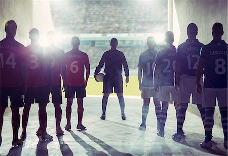 football team - Silhouette of soccer teams facing field Stock Photo - Premium Royalty-Free, Code: 6113-07588834