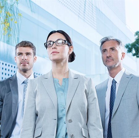 Serious business people outdoors Stock Photo - Premium Royalty-Free, Code: 6113-07588974