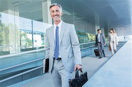 Portrait of businessman leaving office Stock Photo - Premium Royalty-Free, Code: 6113-07588984