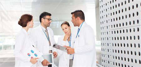 people hospital - Doctors talking in hospital corridor Stock Photo - Premium Royalty-Free, Code: 6113-07588998