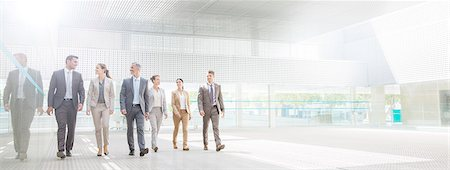 Business people walking in modern courtyard Stock Photo - Premium Royalty-Free, Code: 6113-07588903