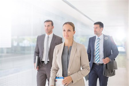Business people walking in corridor Stock Photo - Premium Royalty-Free, Code: 6113-07588905