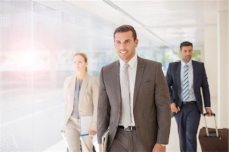 Business people walking in corridor Stock Photo - Premium Royalty-Free, Code: 6113-07588908