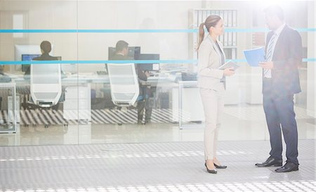 Business people talking outside office Stock Photo - Premium Royalty-Free, Code: 6113-07588916
